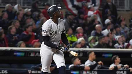 Cameron Maybin of the Yankees watches his home