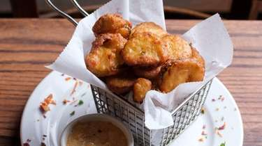 The fried pickles, served with a remoulade sauce,