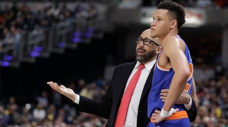 Knicks coach David Fizdale talks with Kevin Knox