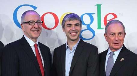 Cornell University president David Skorton, left, Google co-founder