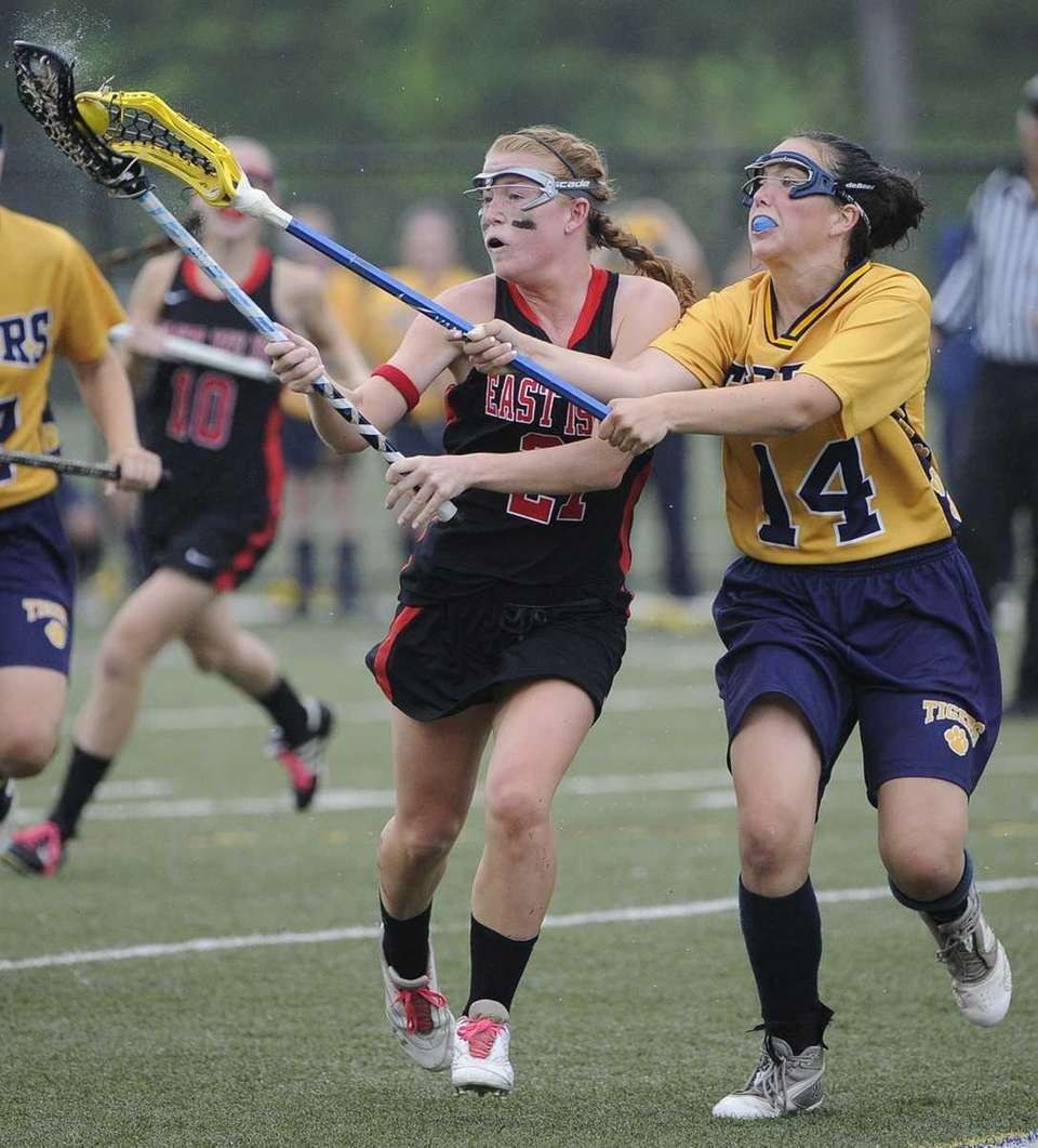 Northport's Annie Dodge checks the ball away from