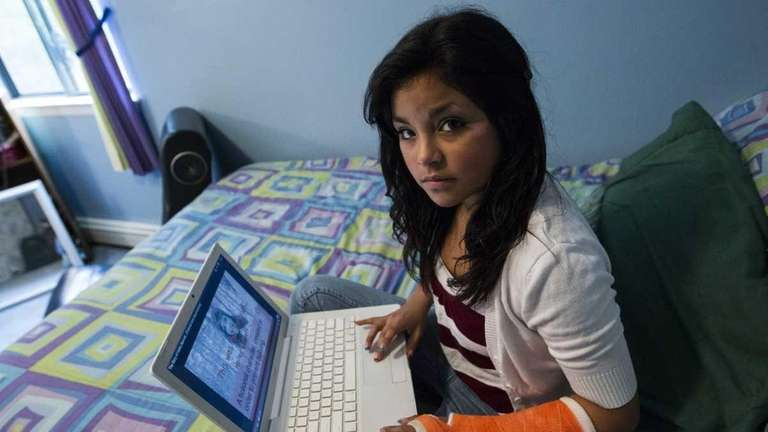 Jessica Barba, 15, sits in her bedroom in
