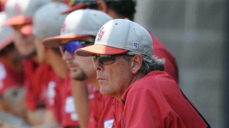 Stony Brook baseball coach Matt Senk watches as