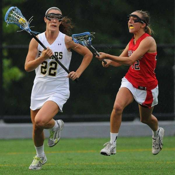 St. Anthony's Maggie Bill, left, looks to get
