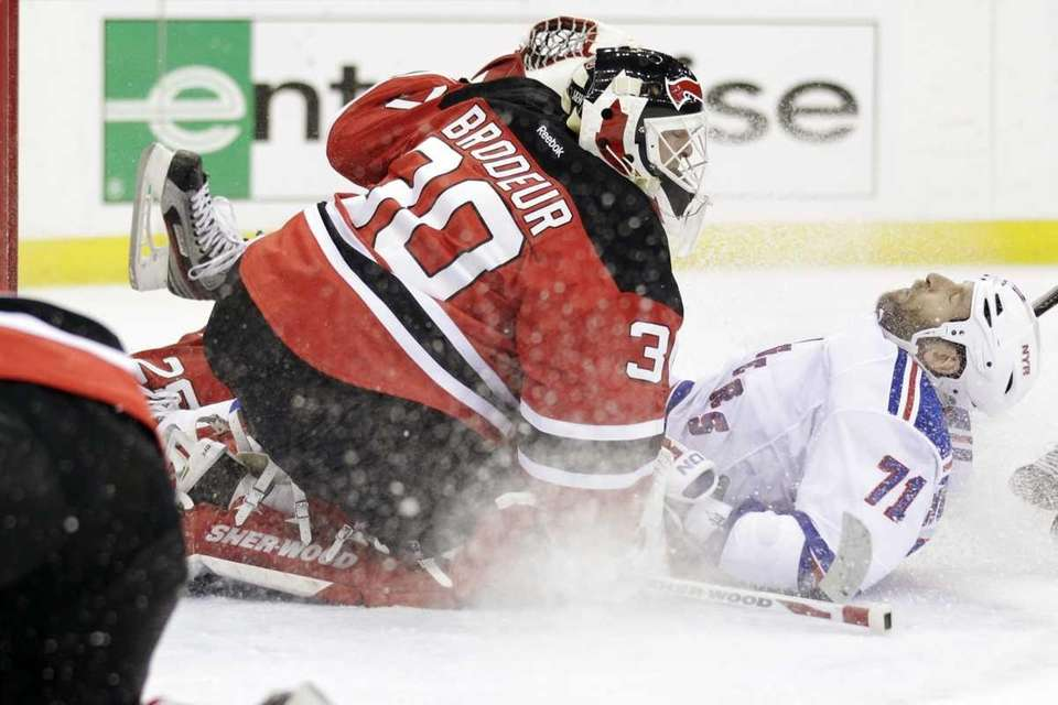 New York Rangers' Mike Rupp, right, falls back