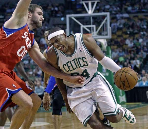 Boston Celtics' Paul Pierce, right, tries to drive