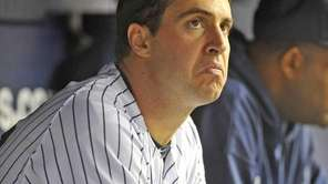 Mark Teixeira watches the game from the bench