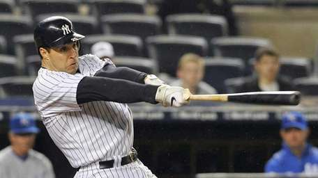 Mark Teixeira doubled to lead off the ninth