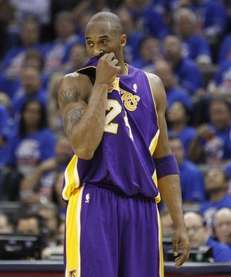 Los Angeles Lakers guard Kobe Bryant wipes his