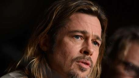 Brad Pitt attends a news conference for