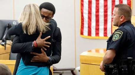 Botham Jean's younger brother Brandt Jean hugs convicted