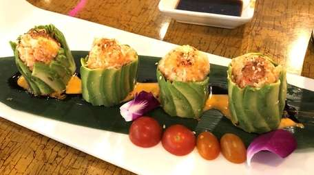 Avocado dumplings beautifully and creatively presented at Fuku,