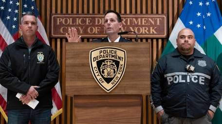 NYPD Deputy Chief Timothy McCormack, center, addresses questions