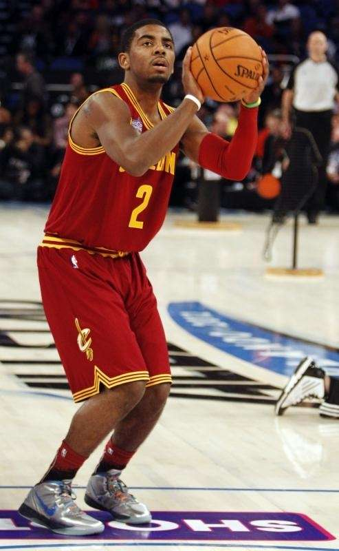 Cleveland Cavaliers' Kyrie Irving (2) participates in the
