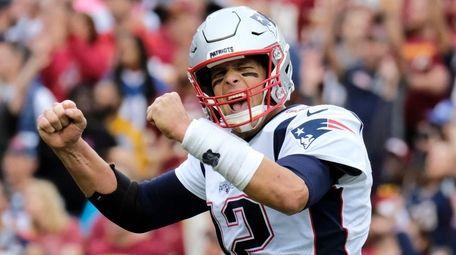 Patriots quarterback Tom Brady reacts to a touchdown