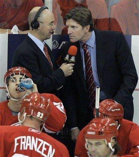 NBC commentator Pierre McGuire, left, interviews Detroit Red
