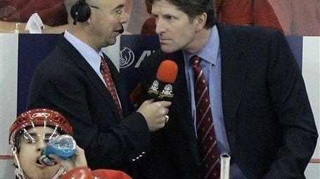 NBC commentator Pierre McGuire, left, interviews Detroit Red