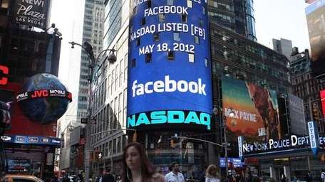 The Nasdaq board in Times Square advertises Facebook