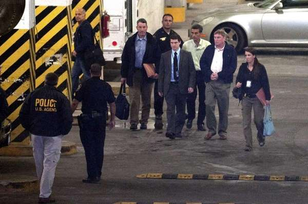 Federal agents transport two LIRR retires in the