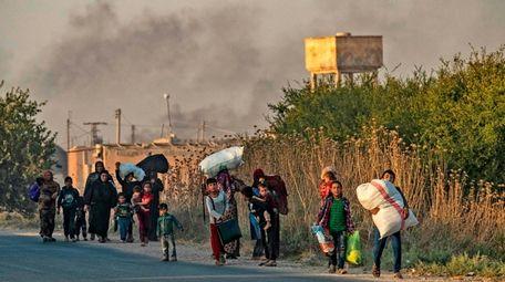 Civilians flee Wednesday amid Turkish bombardment in Hasakeh