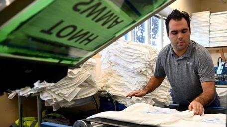 Andrew King works at Spectrum Designs' screen printing