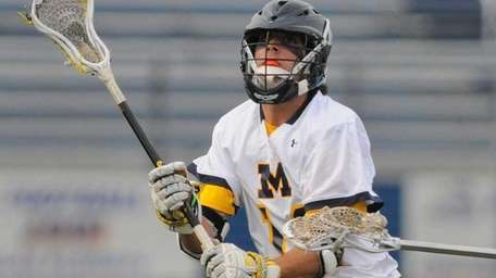 Massapequa's Craig Berge makes a pass in the
