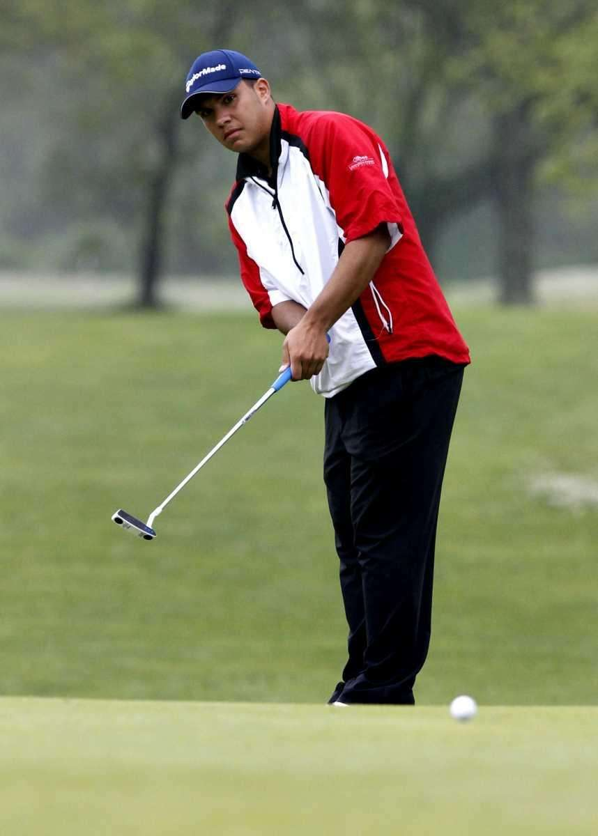 Mike Miranda of Middle Country putts on the