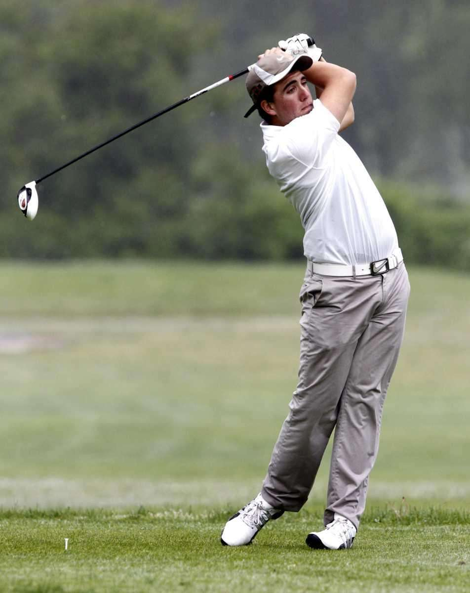 Dominick Reila of Ward Melville tees off at