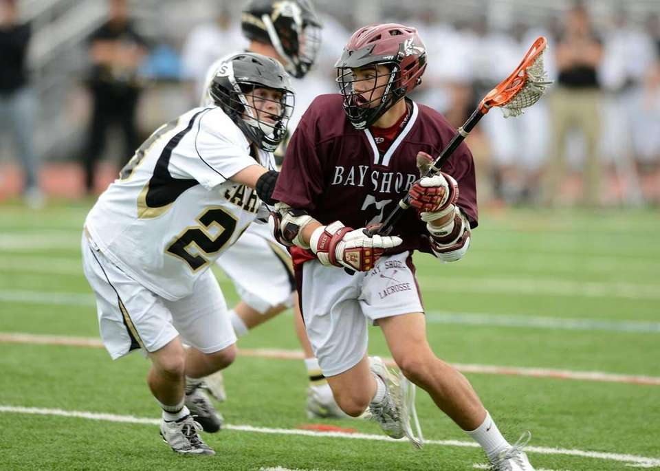 Bay Shore's TJ Delyra (7) drives hard for