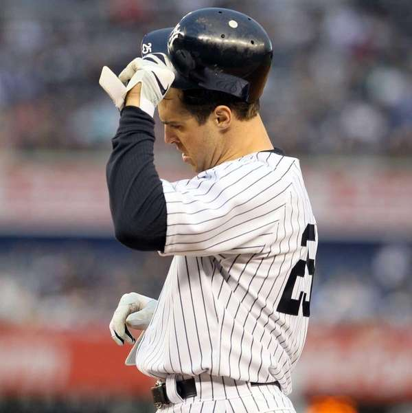 Mark Teixeira reacts after hitting into a second