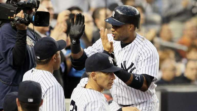 Robinson Cano celebrates his fourth inning home run