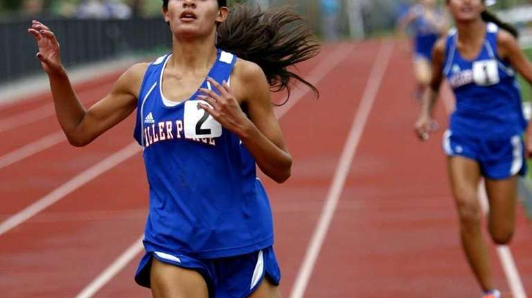 Miller Place's Tiana Guevara (2) edges her twin