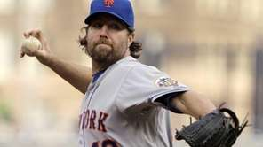 Mets pitcher R.A. Dickey throws during the first