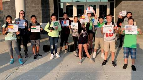 Students at Hampton Bays Middle School greet their
