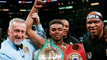 Errol Spence Jr., center, celebrates his victory over