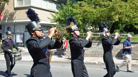 The Manhasset High School marching band performs in