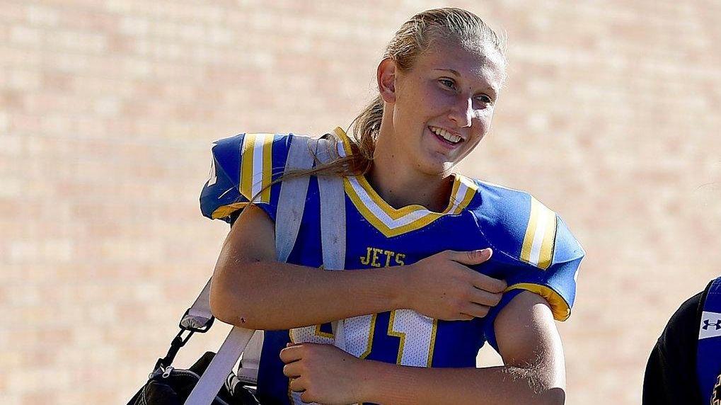 Stephanie Sparkowski, left, walks toward the football field