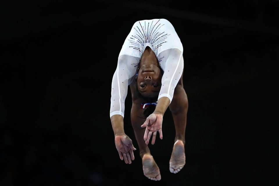 Simone Biles performs on the balance beam during