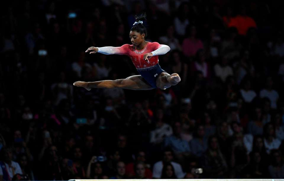 Simone Biles performs on the beam during the