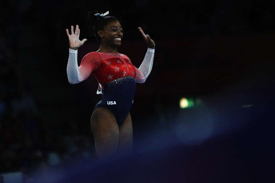 Simone Biles reacts after performing on the floor