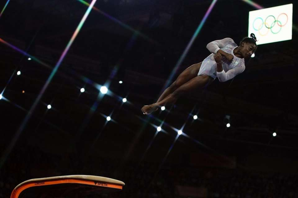 Simone Biles performs on the vault during the