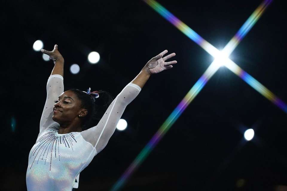 Simone Biles reacts after performing on the vault