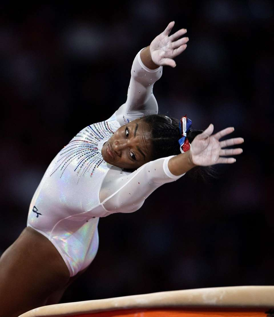 Simone Biles competes in the vault during the
