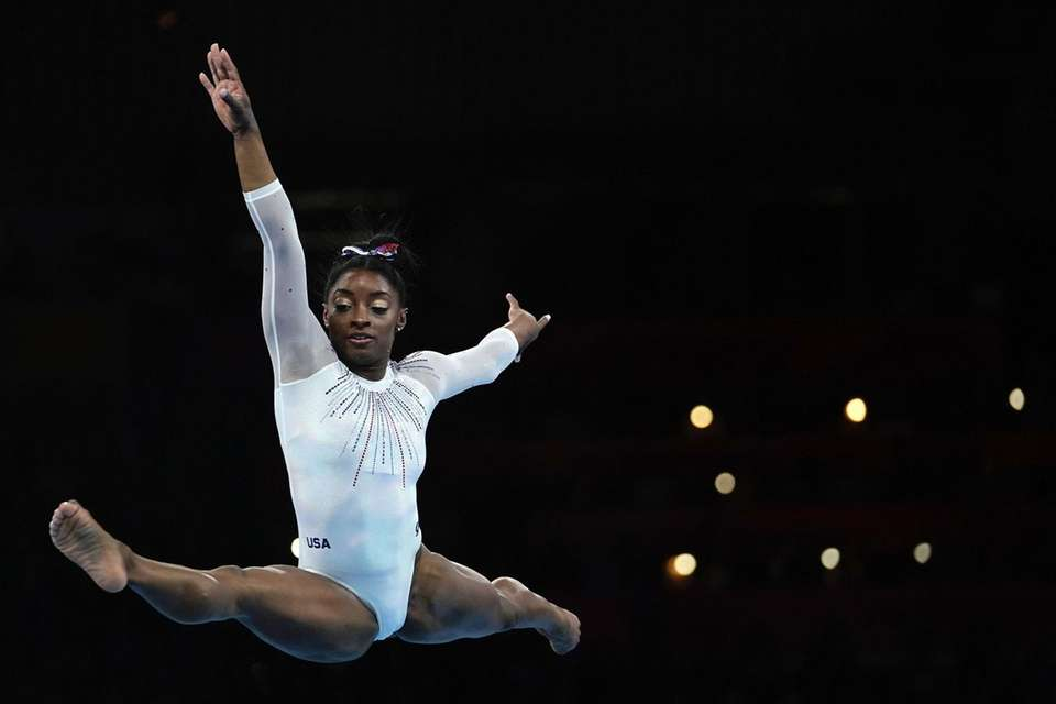 Simone Biles performs on the floor during the