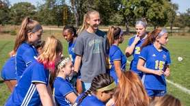 Stephanie Sparkowski shares a laugh with her team