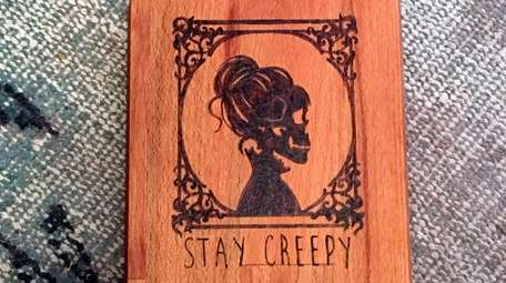 The Stay Creepy cheeseboard from Wit & Whim