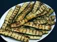 Lengthwise strips of zucchini, brushed with olive oil