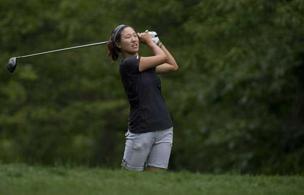 MacArthur's Annie Park tees off at the 18th