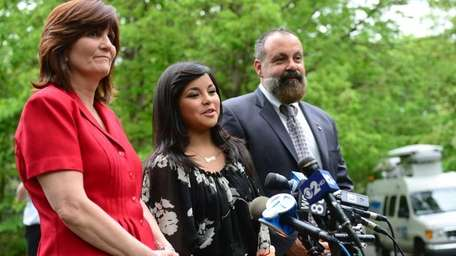 Jessica Barba, 15, is flanked her parents Michael,