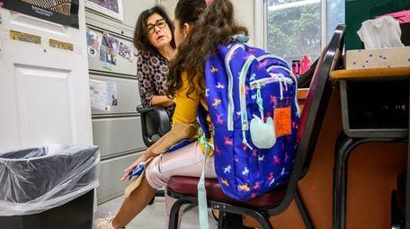 Drexel Avenue Elementary School nurse Barbara Jacobowitz helps